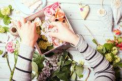 Box with flowers and macaroons Stock Image