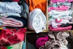 Box with folded clothes. Divided into sections royalty free stock photos