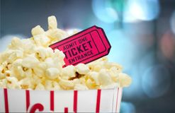 Popcorn food in box and ticket on background royalty free stock images