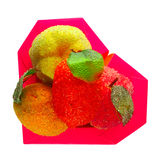 Box in the form of heart with artificial fruits. On white background Royalty Free Stock Photography