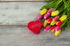 Box in form of heart and tulips Royalty Free Stock Images