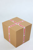 Box with fragile sign. Brown cardboard box sealed with fragile sign Stock Photos