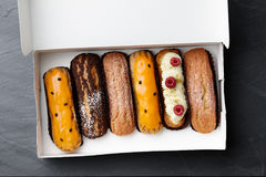 Box of french eclairs Royalty Free Stock Images