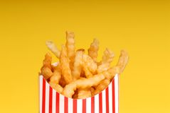 Box of french fries with yellow background Royalty Free Stock Photo
