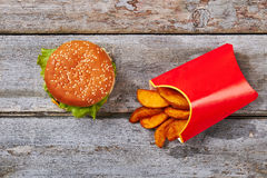 Box of fries and hamburger. Royalty Free Stock Images