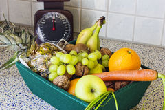 Box of fruit and vegetables on the kitchen table. Still life with fresh fruits and vegetables Stock Photography