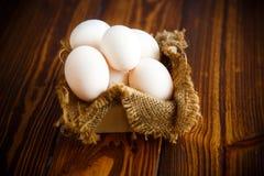 Box full of burlap with eggs Stock Photo