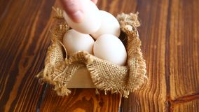 Box full of burlap with eggs. On a wooden table stock footage