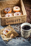 Box full of donuts with coffee Stock Photo