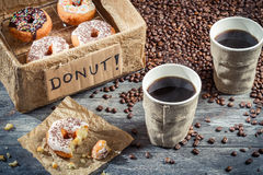 Box full of donuts with coffee for two Stock Photos