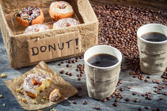 Box full of donuts with coffee for two Royalty Free Stock Photos