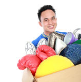 Box full of goodies carried by young man Stock Photos