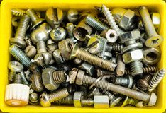Box full of old bolts, different condition and size royalty free stock image