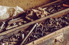 Box full of old screws and nuts in different conditions. royalty free stock images
