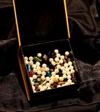 A box full of precious stones Stock Photography