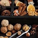 A box full of spices and nuts. On a wooden table top view Royalty Free Stock Photography