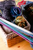 Box full of woolen clues and knitting needles Stock Images