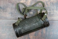 Box for gas mask German troops Wehrmacht, Second World War on wooden background. A box for gas mask German troops Wehrmacht, Second World War on wooden royalty free stock images