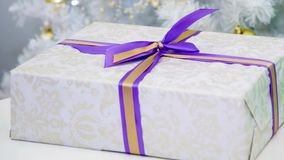 Box gift with bow. Nice mysterious surprise inside. Anniversary and festive Christmas gift for loved ones. Box on a white background for your birthday stock footage