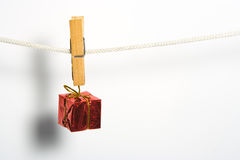 Box gift with bow on rope Royalty Free Stock Photos
