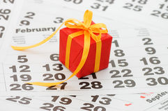 Box with a gift on calendar sheet Stock Photography