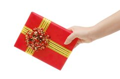 Box with a gift in a hand Stock Photos