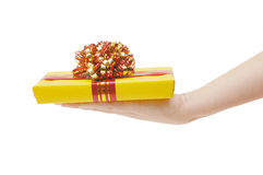 Box with a gift in a hand Royalty Free Stock Image