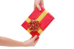 Box with a gift in a hand Stock Image