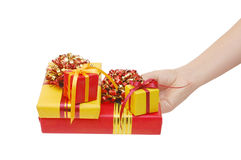 Box with a gift in a hand Stock Images