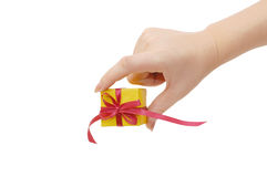 Box with a gift in a hand Royalty Free Stock Photo