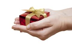 Box with a gift on a hand Royalty Free Stock Images