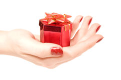 Box with a gift in hand. Red Box with a gift in female hand on a white background Royalty Free Stock Images