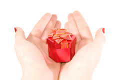 Box with a gift in hands. Red Box with a gift in female hands on a white background Royalty Free Stock Photography