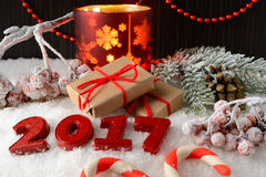 Box with a gift and New Year decorations Royalty Free Stock Photography
