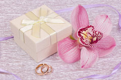 Box for gift and orchid Stock Photography