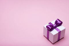 Box with a gift on pink background Stock Image