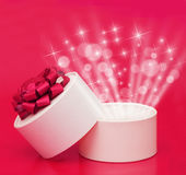 Box with a gift on a red background Stock Image