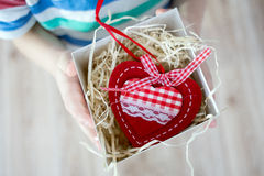 Box with a gift valentine heart in a child& x27;s hand on Valentine& x27;s Royalty Free Stock Images