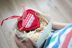 Box with a gift valentine heart in a child& x27;s hand on Valentine& x27;s Stock Image