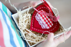 Box with a gift valentine heart in a child& x27;s hand on Valentine& x27;s Royalty Free Stock Image
