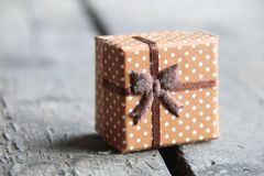 Box with a gift on a wooden table Royalty Free Stock Images