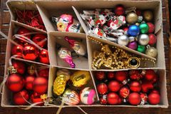 Box with globes and Christmas decorations Stock Photo