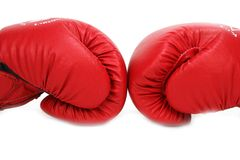 Box Gloves Power. Two Red Boxing Gloves next to each other showing sports and power Royalty Free Stock Photography