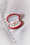 Box with gold wedding rings on the white fabric Stock Photography