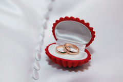 Box with gold wedding rings on the white fabric Royalty Free Stock Image