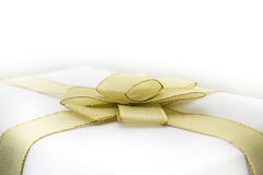 Box with golden bow Stock Image
