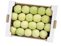 Box of Golden Delicious green yellow apples Stock Photos