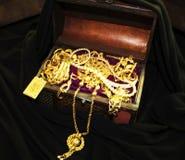 Box with golden jewelery. stock image