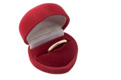 Box with golden ring inside. Velvet heart shaped jewellery box with ring inside Stock Photography