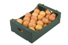 Box of Grapefruits. Box of fresh grapefruits isolated on white background Royalty Free Stock Photos